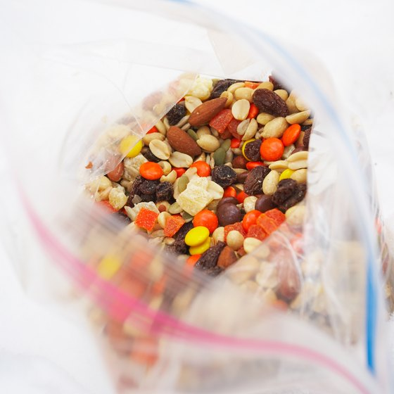 Seal food in plastic zip-close bags to prevent messes on the plane.