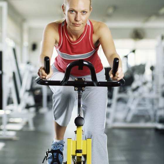 A spin bike can provide a more solid cardiovascular workout than an outdoor bike.
