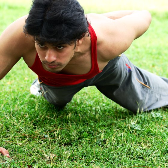 Increase the difficulty of the pushup by using one arm.