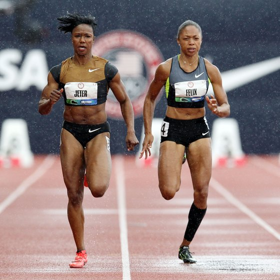 Carmelita Jeter, left, and Allyson Felix battle in the 100 meters.