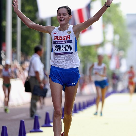 Elena Lashmanova of Russia celebrates winning Olympic gold in the Women's 20K speed walk in London.
