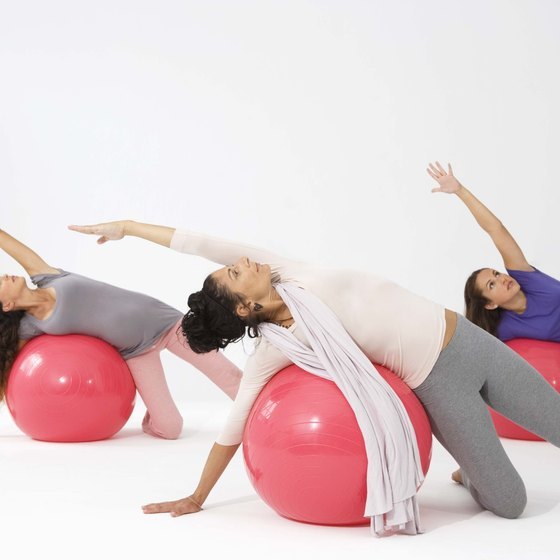 An exercise ball provides support for a side stretch.
