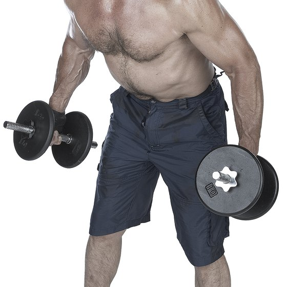 Working out with dumbbells can help you strengthen your lats, important muscles of your back.