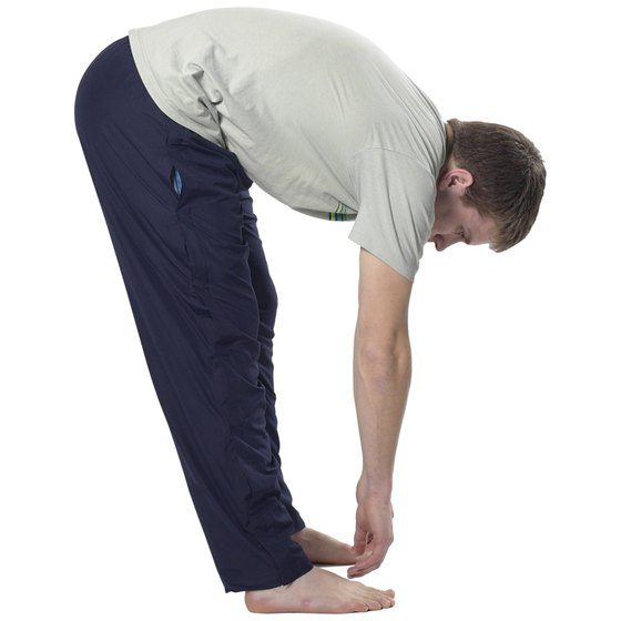 Stretch your back and hamstrings so you can touch your toes.