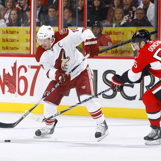 Shane Doan of the Phoenix Coyotes dekes past the defender.