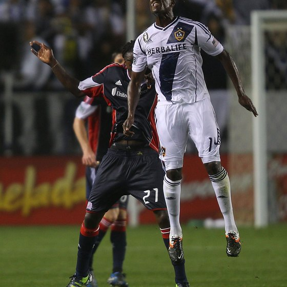 Edson Buddle of the L.A. Galaxy heads the ball.