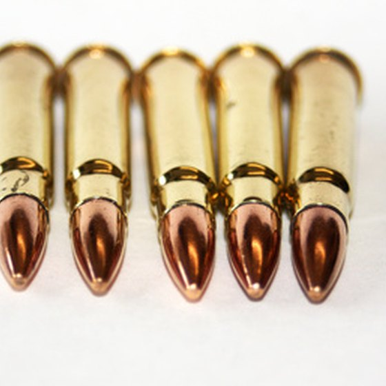 According to Delta Airlines and the Transportation Security Administration, ammunition may be packed in the same container as a weapon.