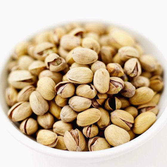 Pistachios and cashews both contain monounsaturated fats, which are beneficial to heart health.