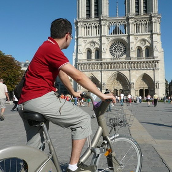 A biker appreciates the Notre Dame Cathedral in Paris.