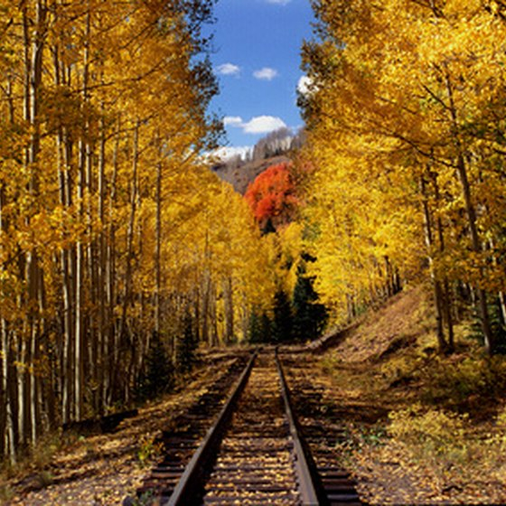 See the Rocky Mountains by train.