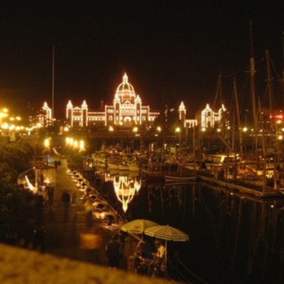 Victoria's Parliament Building lights up the Inner Harbour at night.
