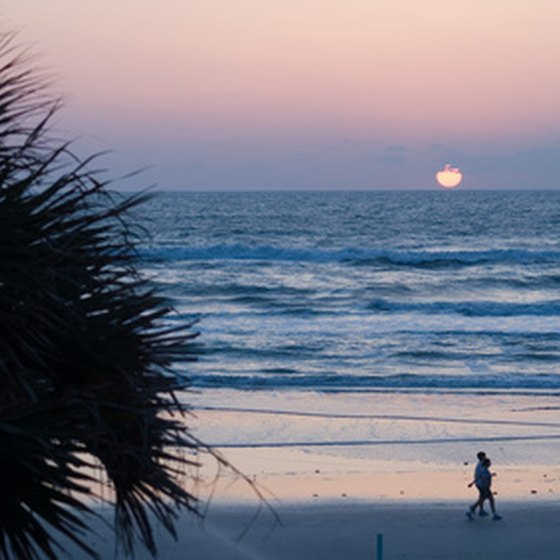Watch the sun set over a Florida beach.