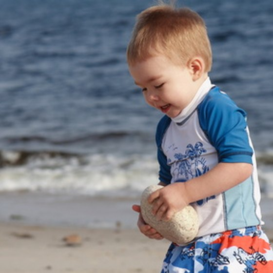 Beaches enthrall toddlers with sand to dig in and lapping water to splash in.