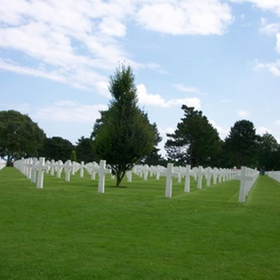 Military tours may include battlefields, museums and cemeteries, such as this one at Omaha Beach.
