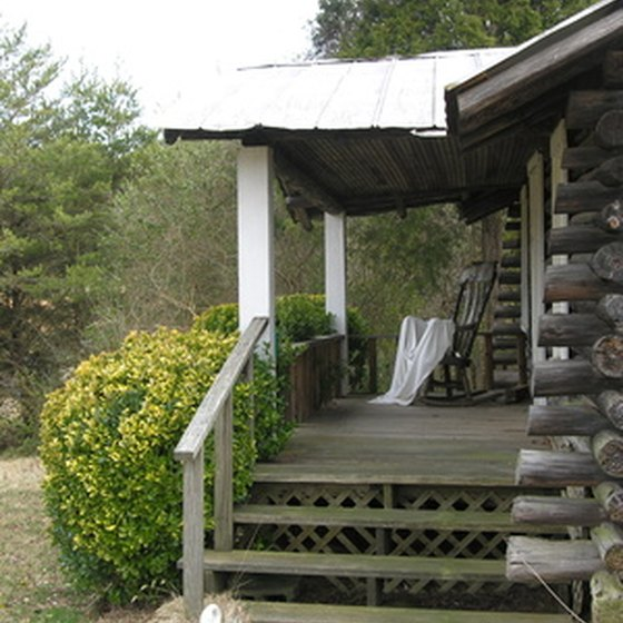 Many Pigeon Forge cabins have rustic decks with rocking chairs.