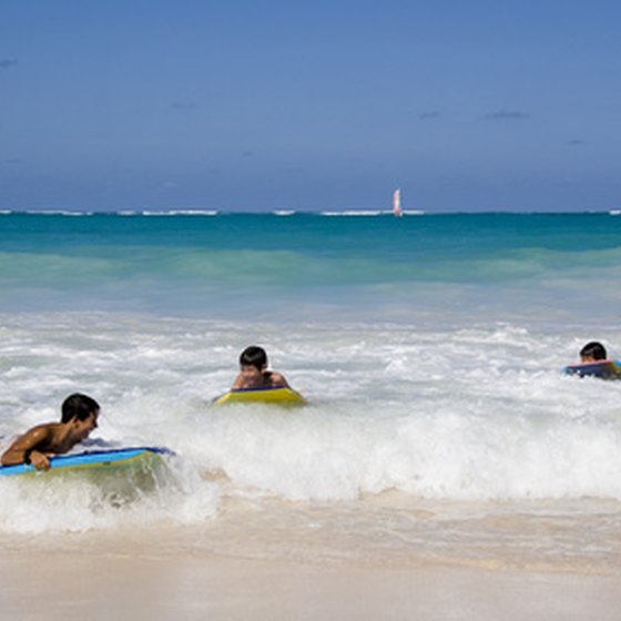 Surfers enjoy the water in Jamaica.