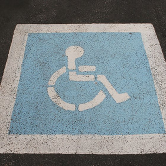 Disney parks have handicap parking and other accommodations for wheelchair users.