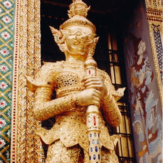 A statue guards the entrance to one of Bangkok's many Bhuddist temples.