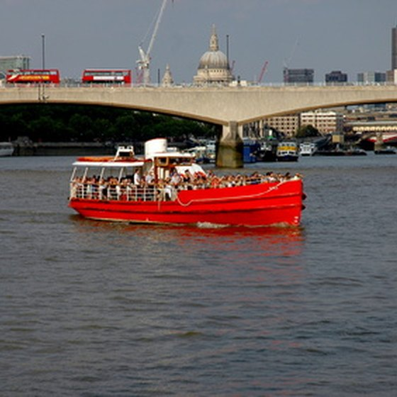 Sightseers cruise the River Thames.
