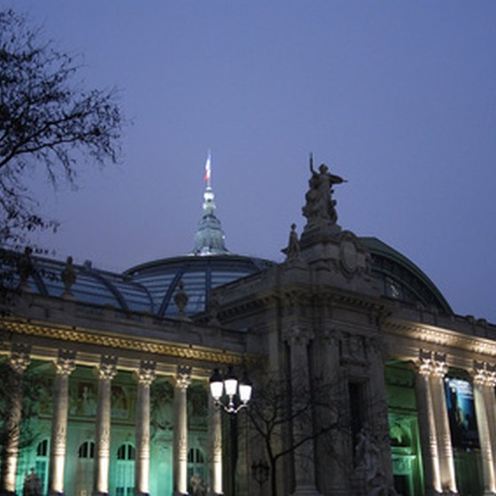 Paris at night reveals the city's famous landmarks illuminated in floodlights.