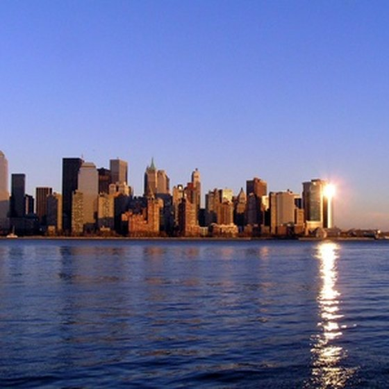See the sun set over Manhattan on an evening cruise around New York Harbor.