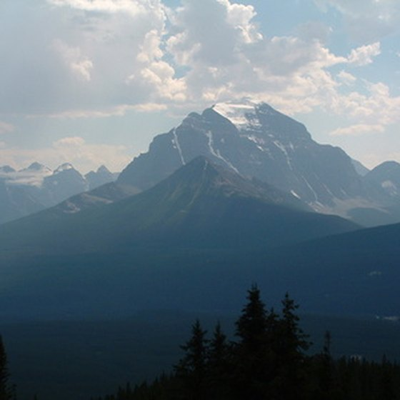 The Canadian Rockies brush the distant sky.