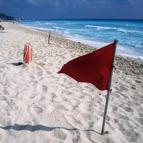 Miles of white sand draw famlies the beach in Cancun, Mexico.
