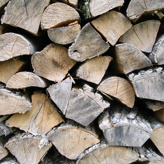 To season firewood, split and stack it properly.