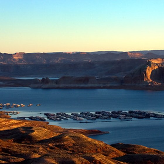 The sun rises over the red rocks at Lake Powell.