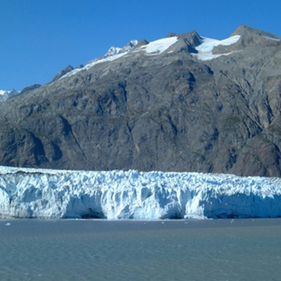 A glacier flows into the water at Glacier Bay National Park.