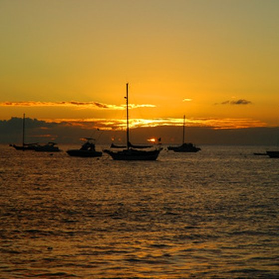 Enjoy a Maui sunset from the deck of a dinner cruise vessel