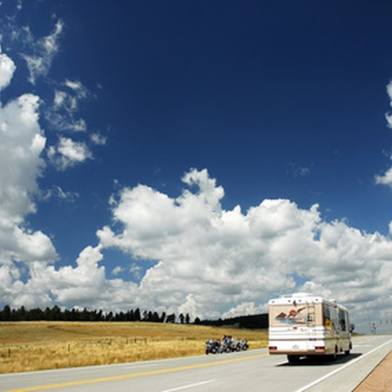 An RV cruising down an open road.