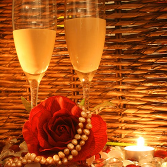 Dinner and drinks by candlelight is one of many ways to make an evening romantic.