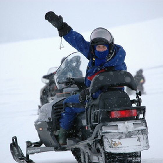 Bundle up for snowmobiling in Breckenridge.