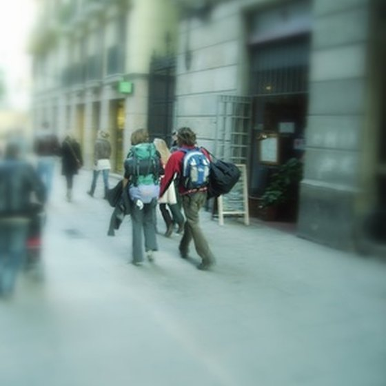 Backpackers walking through Barcelona