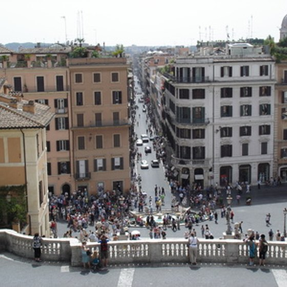 The Spanish Steps overlook the Fontana della Barcaccia.