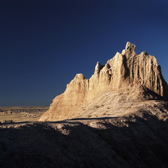 Visitors can wake up to Badland's piercing pinnacles when they stay in the park.