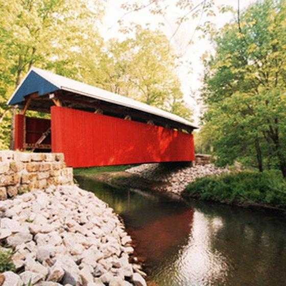 Take a scenic drive through a covered bridge like this one.