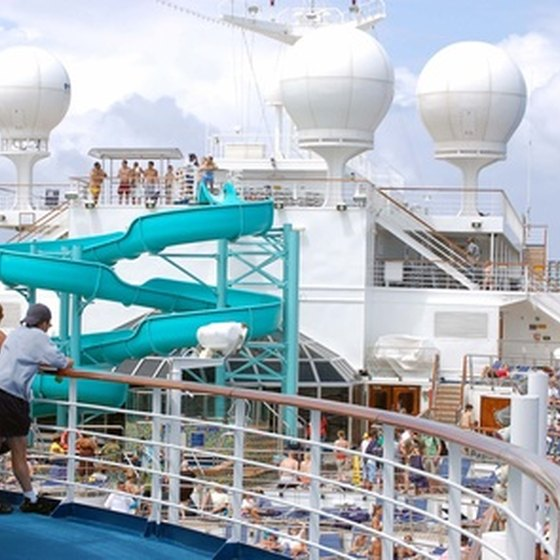 Passengers enjoy the pool view aboard a cruise ship.