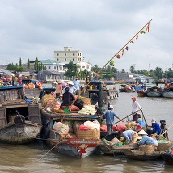 Buyers and sellers meet at a floating market in the Mekong Delta region.