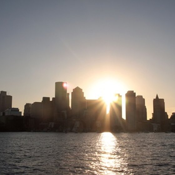 Dinner cruises allow visitors to watch the sun set over the city of Boston.