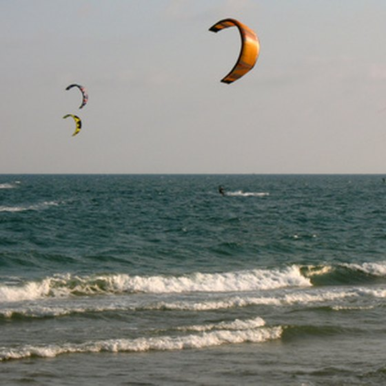 Kites fly along the beach during the festival.