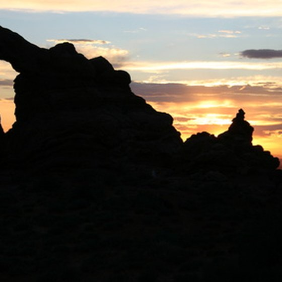 The sun sets over one of the thousands of arches in Arches National Park.