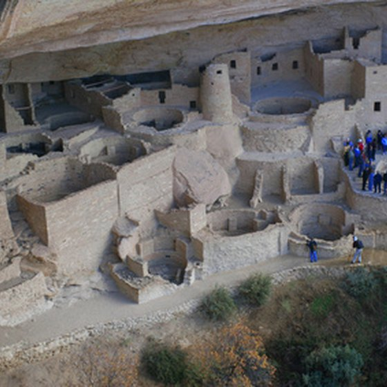 In summer, park rangers guide visitors through the cliff dwellings.