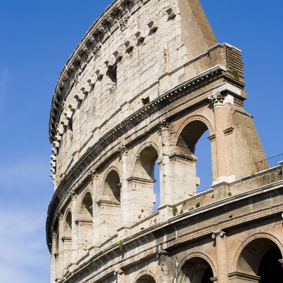 Explore the ruins of the Colosseum in Rome.