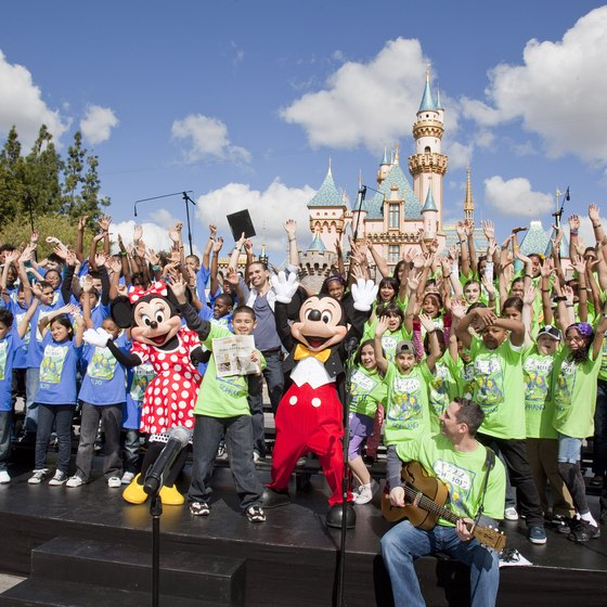 Visitors have fun with Mickey at Disneyland.
