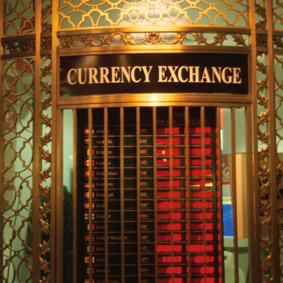 Current exchange rates are listed at the foreign exchange facility.