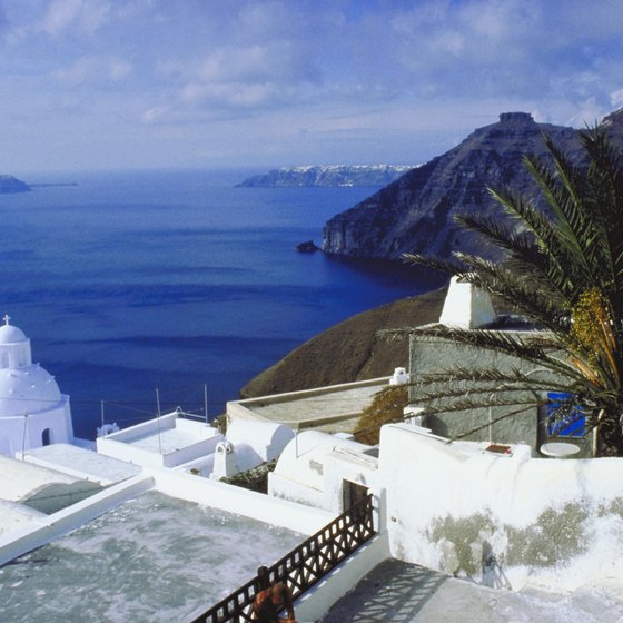 The bleached-white coastal villages of Santorini sharply contrast with the cobalt waters of the Aegean Sea.