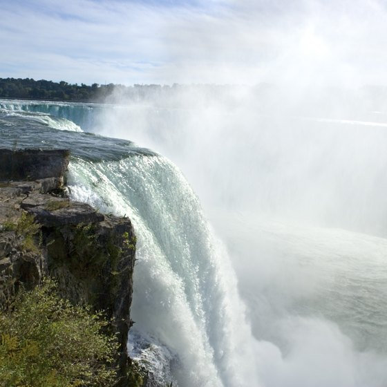 Horseshoe Falls, American Falls and Bridal Veil Falls join together to form Niagara Falls.