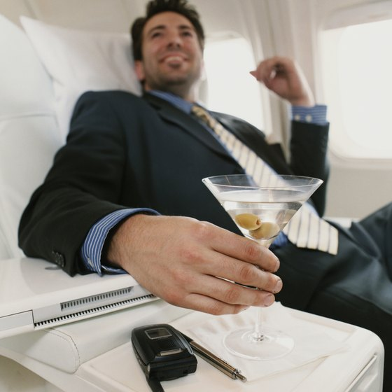 Enjoy a free adult beverage in first class.